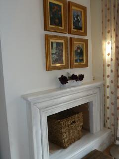 The marble fireplace inside the bedroom