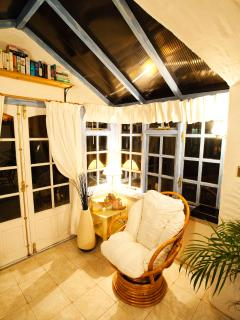 Conservatory with seating and TV
