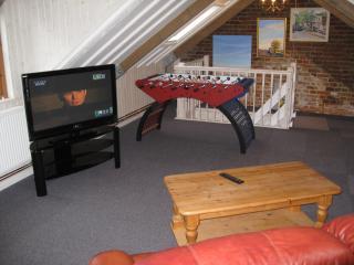 Lounge 42'' LCD TV, Table Football, Lazy Boy Sofa