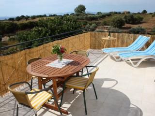 Front downstairs balcony overlooking Olive grove with views of Zante.