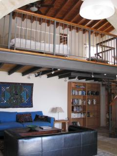 Bookshelves and Stairs to Mezzanine Bedroom