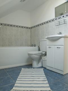 Bathroom with bath & separate shower + another shower room on ground floor with separate loo
