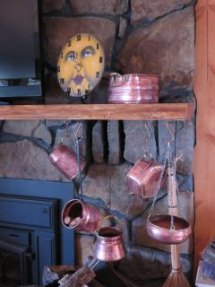 Copper collection on the fireplace. New remote controlled gas fireplace.