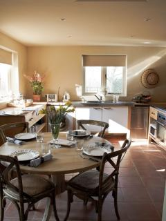 Kitchen, south facing with french doors to terrace, views of tennis court, garden and farmland