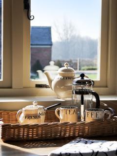 Kitchen views to landscaped gardens and farmland. Emma Bridgewater pottery.