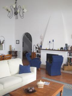 The large, high vaulted livingroom
