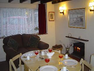The other end of the lounge with table set for dinner