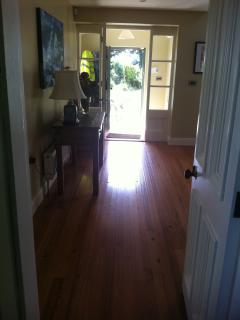 Hall way and main reception room with reclaimed 200 year old pine floors