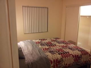 second bed room with twin   bed and tv/tv games