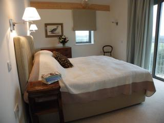 Dutch Barn main bedroom with a balcony view. Twin or double with plenty of space for a cot/putup