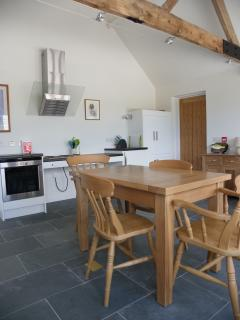 Dairy Cottage kitchen/living room. The variable height cooking area and the kitchen table for 4