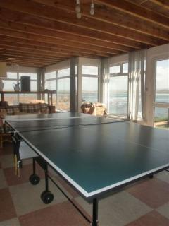 Games/dining area with views out to sea. Full-size table tennis table and selection of board games