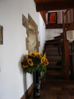 Stairs leading up to the two bedrooms