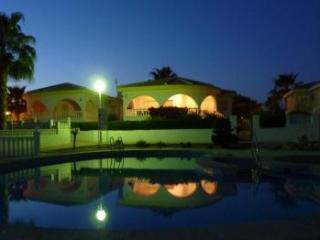 Pool and villa at night
