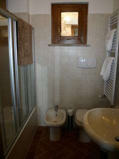 Bathroom with fully enclosed Shower