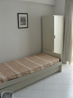 One of the 2 single beds in the 2nd bedroom