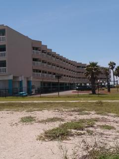 Beach view of condo (condo is in middle section)