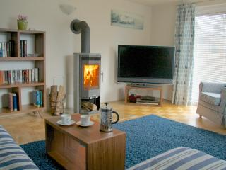 Relax in front of the wood stove on Spring and Autumn evenings.