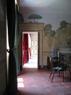 The fresco room leads off a large marbled reception room