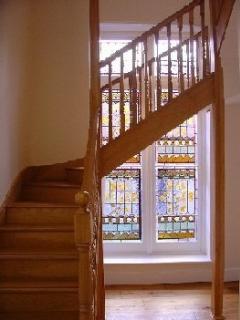 Original victorian glass stain window in communal lobby.