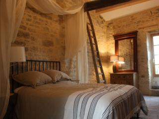 One of the bedrooms with original stone walls and heritage features