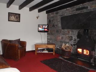 Relax in front of the log burning stove.  Views acroos the loch