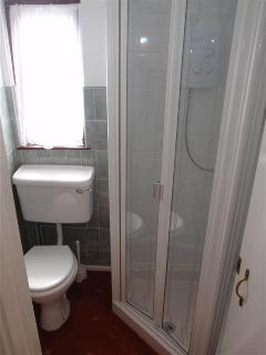 Bathroom with electric shower,  New floor December 2013. the cottage also has a downstairs toilet