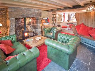 Tresillian has a spacious but cozy open plan living area with wood burner and underfloor heating