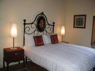 The 'La Soffita' Suite, with antique headboard