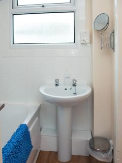 Refurbished bathroom with bath and shower