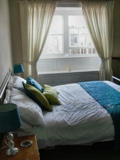Bedroom 2 which overlooks the square is the smallest of the double bed rooms