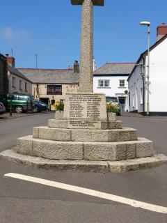 The war memorial takes pride of place at the bottom of the square