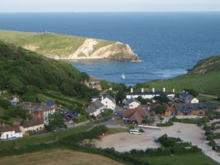 Lulworth Cove showing Rose Cottage on the left hand side.