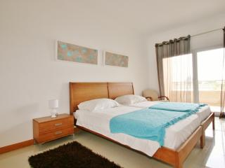 Bedroom with Air-Con and Pool & Sea Views