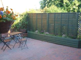 Private courtyard area with seating for 4