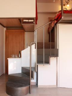 Custom made swirling staircase to bed and closet with plenty of headroom