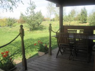 Outdoor decked area on the lodge overlooks the tranquil fishing lake.