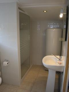 Walk-in shower + heated towel rail. Hairdryer & toiletries are supplied.