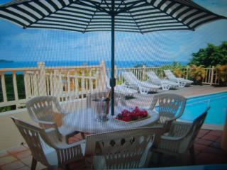 Relax by the pool with that glass of wine overlooking the beautiful views of Caribbean & Castries