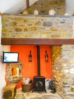 Featuring an inglenook fire place an ancient stone bread oven with Stunning Log Burner