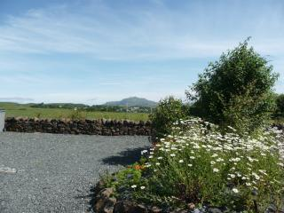 Flower beds and views over the fields at Blacksmiths Cottage