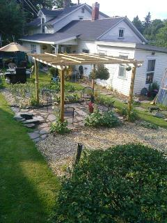 Newly Installed Pergola with fire pit...Enjoy a beautiful sunny day with outdoor seating in the garden area...and warm...