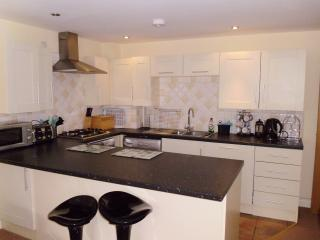 Fully fitted kitchen and breakfast bar