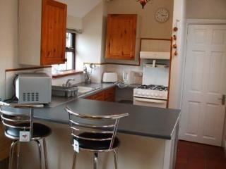 Kitchen and Breakfast bar but if you prefer we have tables for your use.
