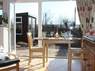 Large windows provide a light airy interior with views out onto your patio ,garden and summer house.