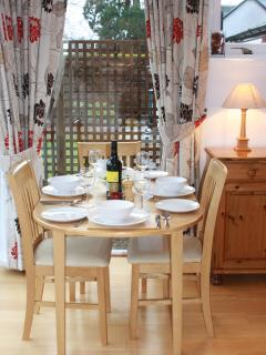 Dining area with extending table to seat four.