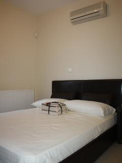 3rd bedroom with double bed and wardrobes