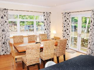 The delightful dinining room with access to the rear garden.