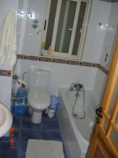 Main Bathroom wwith washing machine and dryer