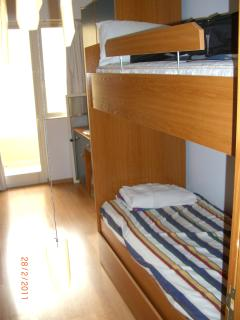 Spare Bedroom having 2 bunks, plus extra bed at bottom